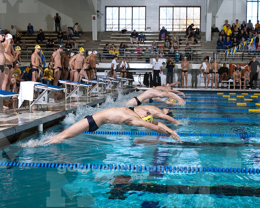 The University of Michigan men's swimming and diving team beat Texas (150.5-149.5) and Indiana (216-84) in double dual action at  Canham Natatorium in Ann Arbor, Mich., on November, 5 2011.