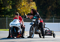 Sep 15, 2019; Mohnton, PA, USA; NHRA pro stock motorcycle rider Steve Johnson (left) reacts alongside a crew member after losing in the final round of the Reading Nationals at Maple Grove Raceway. Mandatory Credit: Mark J. Rebilas-USA TODAY Sports