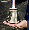 Ring the Bell for freedom Troop Tribute Race at Delaware Park on 7/3/14<br /> Lt. Col. Joel Briske The Commander Security Forces Squadron Dover Air Force Base  holding The Freedom Bell crafted by Malmark, Inc's Tim Schuback