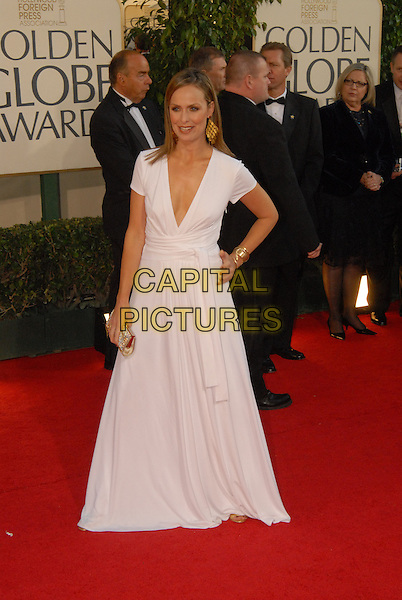 "MELORA HARDIN.Red Carpet Arrivals - 64th Annual Golden Globe Awards, Beverly Hills HIlton, Beverly Hills, California, USA..January 15th 2007.globes full length white dress hand on hip.CAP/AW.Please use accompanying story.Supplied by Capital Pictures.© HFPA"" and ""64th Golden Globe Awards"""