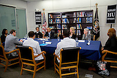 United States President Barack Obama, center left, speaks while participating in a roundtable discussion on the impacts of climate change on public health with Vivek Murthy, U.S. surgeon general, left, Gina McCarthy, administrator of the Environmental Protection Agency (EPA), second from right, and Charlotte Wallace, sustainability coordinator at Anne Arundel Medical Center, third from right, at Howard University in Washington, D.C., U.S., on Tuesday, April 7, 2015. The President is warning that climate change will start affecting Americans' health in the near future and he is recruiting top technology companies to help prepare the nation's health systems.<br /> Credit: Andrew Harrer / Pool via CNP