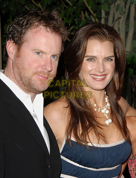 CHRIS HENCHY & BROOKE SHIELDS.attends Noche de Ninos Gala benefiting Children's Hospital of Los Angeles held at The Beverly Hilton Hotel, .Beverly Hills, California, USA, October 7th 2006. .portrait headshot couple blue and white dress necklace sheilds.Ref: DVS.www.capitalpictures.com.sales@capitalpictures.com.©Debbie VanStory/Capital Pictures