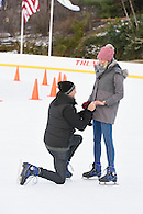 Guy on his knees proposing to girlfriend.
