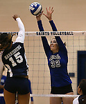Marymount's Emily Shultis blocks in a college volleyball match against PSU Harrisburg at Marymount University in Arlington, Vir., on Wednesday, Oct. 9, 2013.<br /> Photo by Cathleen Allison