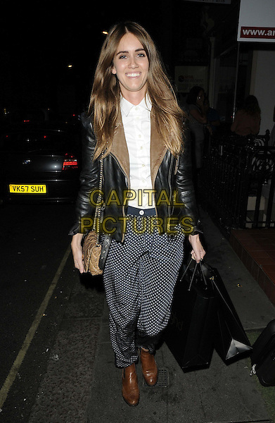 Jade Williams aka Sunday Girl.The ghd air boutique launch party, Art Galleries Europe, Maddox St., London, England..September 5th, 2012.full length black leather jacket blue polka dot trousers goody bags brown boots .CAP/CAN.©Can Nguyen/Capital Pictures.
