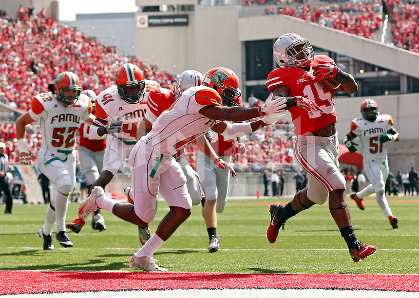 Ohio State Buckeyes running back Ezekiel Elliott (15) gets past Florida A&M Rattlers defensive back Jonathan Pillow (19) to score on a 13 yard run in the 3rd quarter during their college football game at Ohio Stadium on September 21, 2013.  (Dispatch photo by Kyle Robertson)