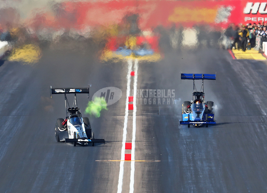 Feb 23, 2019; Chandler, AZ, USA; NHRA top fuel driver Jordan Vandergriff (left) makes his first career competition pass alongside Cameron Ferre during qualifying for the Arizona Nationals at Wild Horse Pass Motorsports Park. Mandatory Credit: Mark J. Rebilas-USA TODAY Sports