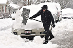 Wayne Cormier clears snow from around his neighbor's car on South Virginia Street in Belleville on Saturday morning January 12, 2019. He had shoveled the sidewalk too. People were busy digging out -- and some were having fun -- after a major snowstorm hit the St. Louis metropolitan region. <br /> Photo by Tim Vizer