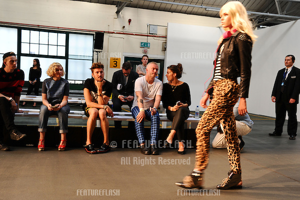 Henry Holland watches models rehearse at the House of Holland catwalk show as part of London Fashion Week SS13, London. 15/09/2012 Picture by: Steve Vas / Featureflash