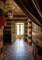 In the ground floor apartment, opulent wool curtains from de Le Cuona section the hallway off from the library