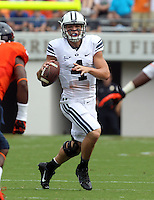 Brigham Young quarterback Taysom Hill (4) handles the ball during the first half of the game in Charlottesville, Va. Virginia defeated Brigham Young 19-16. Photo/Andrew Shurtleff