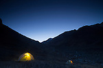 Camp in canyon at night, Sarychat-Ertash Strict Nature Reserve, Tien Shan Mountains, eastern Kyrgyzstan