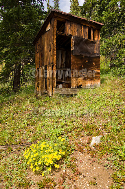 Weathered wooden outhouse in a ghost town in the Colorado Rocky Moutains