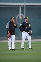 Pittsburgh Pirates coach Kimera Bartee (18) and Garth Brooks (7) during the teams first Spring Training practice on February 18, 2019 at Pirate City in Bradenton, Florida.  (Mike Janes/Four Seam Images)