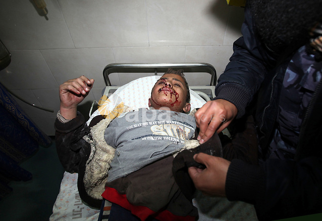 A wounded Palestinian boy is wheeled into a hospital in Gaza City, after an Israeli air strike March 12, 2012. Israeli air strikes killed two Palestinian militants and a civilian in the Gaza Strip on Monday in a fourth day of cross-border hostilities, medical sources said. Photo by Yasser Qudeh