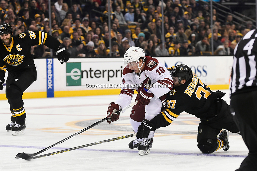 February 28, 2015 - Boston, Massachusetts, U.S. - Arizona Coyotes right wing Shane Doan (19) and Boston Bruins center Patrice Bergeron (37) battle for the puck during the NHL match between the Arizona Coyotes and the Boston Bruins held at TD Garden in Boston Massachusetts. Eric Canha/CSM