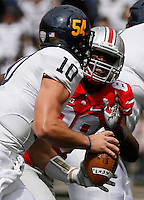 Kent State Golden Flashes quarterback Colin Reardon (10) is pursued by Ohio State Buckeyes defensive lineman Steve Miller (88) during Saturday's NCAA Division I football game at Ohio Stadium in Columbus on September 13, 2014. Ohio State won the game 66-0. (Dispatch Photo by Barbara J. Perenic)