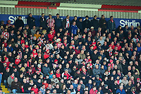 Lincoln City fans watch their team in action<br /> <br /> Photographer Andrew Vaughan/CameraSport<br /> <br /> The EFL Sky Bet League Two - Lincoln City v Cheltenham Town - Saturday 13th April 2019 - Sincil Bank - Lincoln<br /> <br /> World Copyright © 2019 CameraSport. All rights reserved. 43 Linden Ave. Countesthorpe. Leicester. England. LE8 5PG - Tel: +44 (0) 116 277 4147 - admin@camerasport.com - www.camerasport.com
