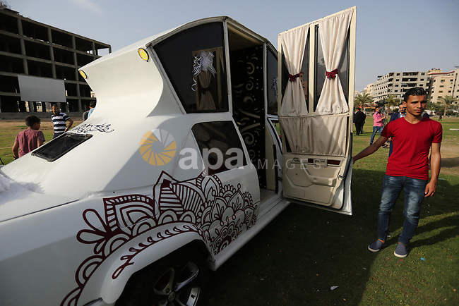 "A Palestinian mechanic display his ""Cinderella"" vehicle in Gaza City on April 22, 2017. Made up of five different cars, it will be rented out for use at marriage ceremonies. Photo by Ashraf Amra"