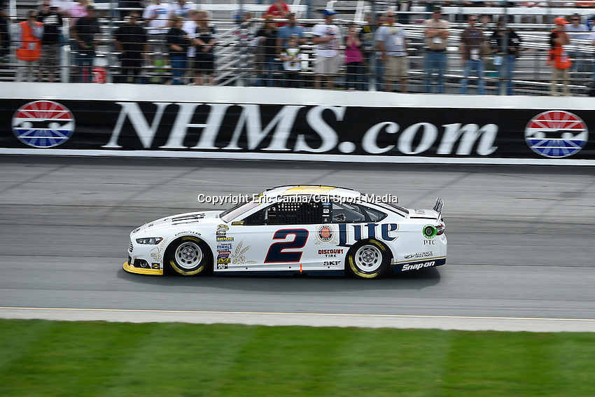 September 21, 2014 - Loudon, New Hampshire, U.S. -  Sprint Cup Series driver Brad Keselowski (2) races into turn 2 at the Nascar Sprint Cup Series Sylvania 300 race held at the New Hampshire Motor Speedway in Loudon, New Hampshire.   Eric Canha/CSM