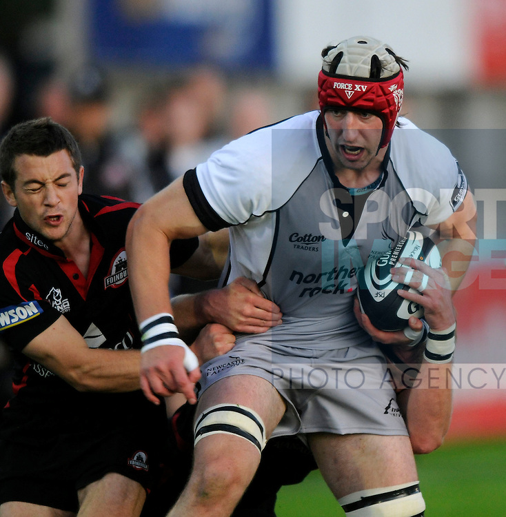 Newcastle's Peter Browne (R) is tackled by Edinburgh's Greig Laidlaw.