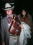 Larry Hagman and Linda Gray at the Kennedy Airport in New York City in 1982.