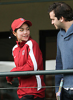 STANFORD, CA - January 29, 2011:  Hilary Barte talks with a fan during a rain delay in Stanford's 6-1 victory over Oklahoma at Stanford, California on January 29, 2011.