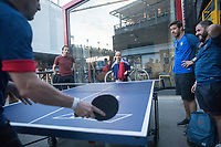 MOSCOW, RUSSIA - June 16, 2018: France fans play a game of ping pong at the Red October complex in Moscow during the 2018 FIFA World Cup.