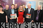 COMMITTEE: The Kilgarvan Historical and Photographic Society who are behind the new social history book Moments and Memories. Front l-r: Orla Hyde, Tommy JT Randles (chairman), Sinead Kelleher, Minister Jimmy Deenihan, Danny O'Sullivan. Back l-r: Jerry Morley, Con Traynor, Thomas Reilly.