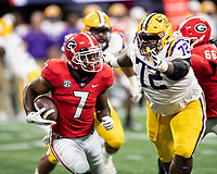 ATLANTA, GA - DECEMBER 7: D'Andre Swift #7 of the Georgia Bulldogs runs with the ball as Tyler Shelvin #72 of the LSU Tigers attempts to tackle him during a game between Georgia Bulldogs and LSU Tigers at Mercedes Benz Stadium on December 7, 2019 in Atlanta, Georgia.