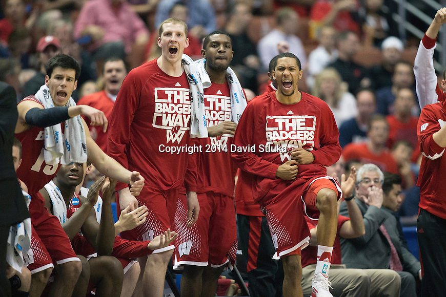 Wisconsin Badgers teammates cheer during  the Western Regional Final NCAA college basketball tournament game against the Arizona Wildcats Saturday, March 29, 2014 in Anaheim, California. The Badgers won 64-63 (OT). (Photo by David Stluka)