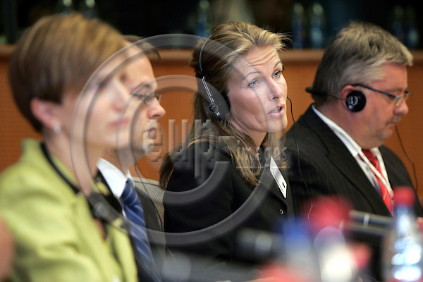 BRUSSELS - BELGIUM - 13 JULY 2006 -- EU-Parliament hearing of the Finnish Ministers of the EU-Presidency. -- Tanja SAARELA (Ce), Minister of Culture and Susanna HUOVINEN (Le), Minister of Transport and Communications of Finland during the hearing in the European Parliament with Harri SYVÄSALMI (Ri) (Syvasalmi, Syvaesalmi) Counsellor greeting MEP Hannu TAKKULA (Finland), Group of the Alliance of Liberals and Democrats for Europe. -- PHOTO: JUHA ROININEN / EUP-IMAGES