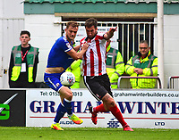 Lincoln City's Ollie Palmer vies for possession with Chesterfield's Scott Wiseman<br /> <br /> Photographer Andrew Vaughan/CameraSport<br /> <br /> The EFL Sky Bet League Two - Lincoln City v Chesterfield - Saturday 7th October 2017 - Sincil Bank - Lincoln<br /> <br /> World Copyright &copy; 2017 CameraSport. All rights reserved. 43 Linden Ave. Countesthorpe. Leicester. England. LE8 5PG - Tel: +44 (0) 116 277 4147 - admin@camerasport.com - www.camerasport.com