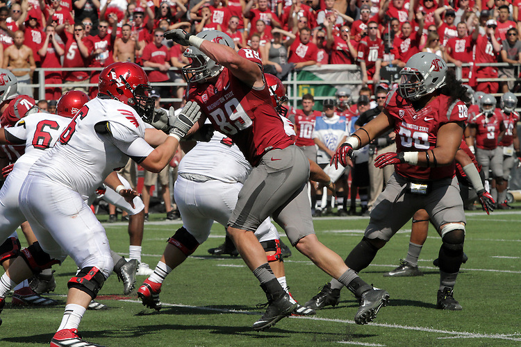 Travis Long applies pressure from the edge during the Washington State home opening football game against Eastern Washington University at Martin Stadium in Pullman, Washington, on Saturday, September 8, 2012.  The Cougars prevailed over the Eagles in a hard fought game, 24-20.