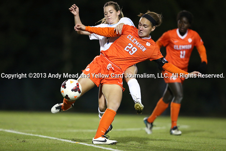 20 October 2013: Clemson's Katie Sprouse (29) and North Carolina's Kealia Ohai (behind). The University of North Carolina Tar Heels hosted the University of Virginia Cavaliers at Fetzer Field in Chapel Hill, NC in a 2013 NCAA Division I Women's Soccer match. North Carolina won the game 2-0.