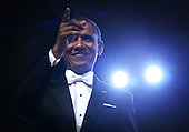 United States President Barack Obama acknowledges the crowd during the Inaugural Ball January 21, 2013 at Walter E. Washington Convention Center in Washington, DC. Barack Obama was re-elected for a second term as President of the United States.  .Credit: Alex Wong / Pool via CNP