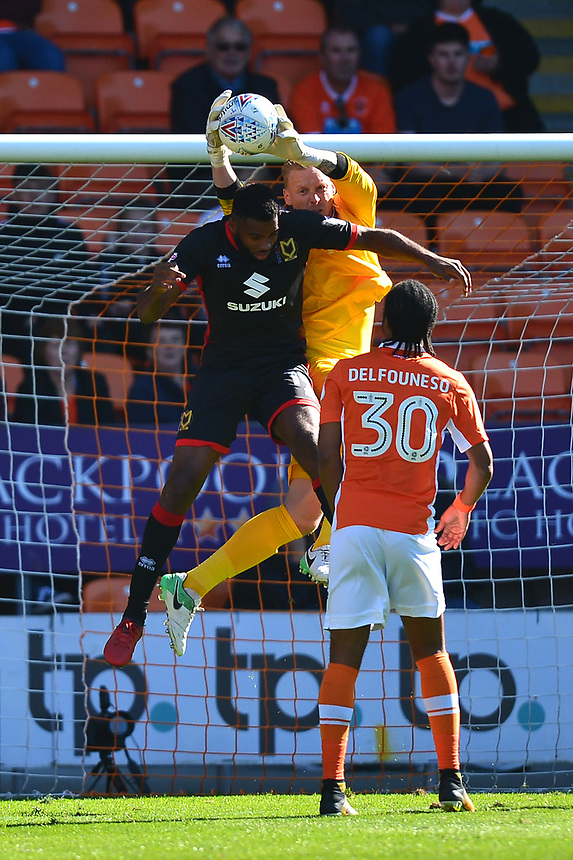 Blackpool's Ryan Allsop claims the ball under pressure from Milton Keynes Dons' Lee Nicholls<br /> <br /> Photographer Richard Martin-Roberts/CameraSport<br /> <br /> The EFL Sky Bet League One - Blackpool v Milton Keynes Dons - Saturday August 12th 2017 - Bloomfield Road - Blackpool<br /> <br /> World Copyright &copy; 2017 CameraSport. All rights reserved. 43 Linden Ave. Countesthorpe. Leicester. England. LE8 5PG - Tel: +44 (0) 116 277 4147 - admin@camerasport.com - www.camerasport.com