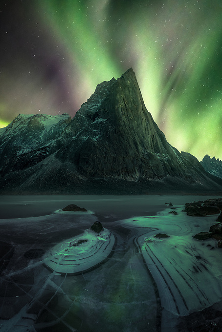 One of many unforgettable auroral displays over the a frozen lake and majestic peaks of the Yukon Territory in early winter.