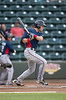 Alec Keller (9) of the Potomac Nationals follows through on his swing against the Winston-Salem Dash at BB&T Ballpark on July 15, 2016 in Winston-Salem, North Carolina.  The Dash defeated the Nationals 10-4.  (Brian Westerholt/Four Seam Images)