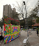 Kaohsiung, Taiwan -- Panoramic view of a traditional Taiwanese hand puppet theater performance at a roadside park in Kaohsiung.
