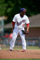 Auburn Doubledays relief pitcher Nector Ramirez (12) looks in for the sign during a game against the Batavia Muckdogs on June 17, 2018 at Falcon Park in Auburn, New York.  Auburn defeated Batavia 10-8.  (Mike Janes/Four Seam Images)
