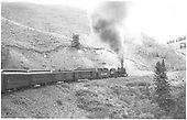 #483 with eastbound San Juan climbing to Cumbres Pass.  Closed vestibule coaches.<br /> D&amp;RGW    Taken by Ward, Bert H. - 7/1947