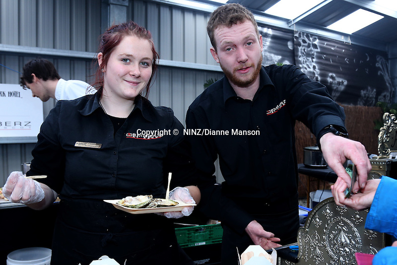 The Ascot Hotel Emberz food stall staff busy at work during the Bluff Oyster and Food Festival, Bluff, New Zealand, Saturday, May 21, 2016. Credit:  Dianne Manson