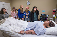 NWA Democrat-Gazette/BEN GOFF @NWABENGOFF<br /> Melanie Nguyen (from left), Morgan Patterson, Lakyn Hawthorne, Brittney Johannsen and Gaby Flores, all Rogers High students, watch a demonstration of a medical mannequin Friday, Jan. 11, 2019, at Northwest Arkansas Community College in Bentonville. About 120 9th-12th grade students from medical professions classes at Rogers High School visited the community college for tours of the health professions building. The field trip was organized by teacher Marty Allen to help the students learn about education and career opportunities in healthcare.