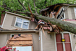 CHESHIRE, CT. 16 May 2018-051618BS89 - A house on Bellamy Road in Cheshire is condemned after a tree sliced through the house during yesterday's strong storms on Wednesday afternoon. Bill Shettle Republican-American