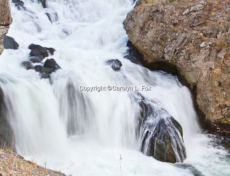 Water rushes over rocks in Yellowstone.