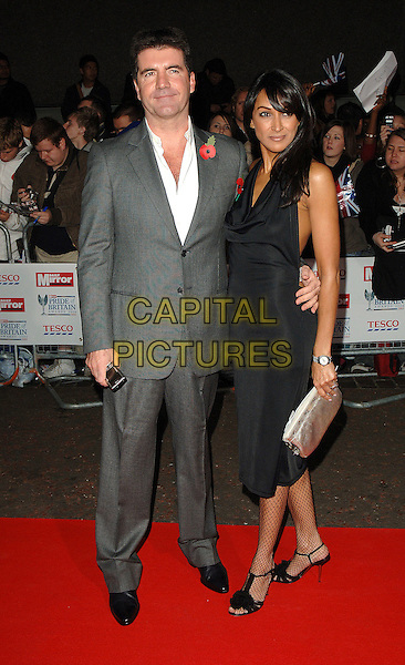 SIMON COWEL & GUEST.Attending The Daily Mirror's Pride Of Britain Awards,.London Television Studios, London, England,.November 7th 2006..full length cowell.Ref: BEL.www.capitalpictures.com.sales@capitalpictures.com.©Tom Belcher/Capital Pictures.