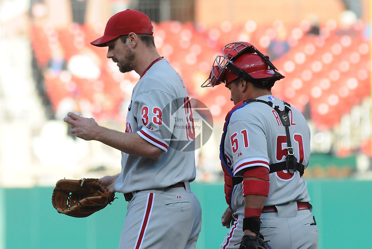 16 May 2011                             Philadelphia Phillies catcher Carlos Ruiz (51) goes out to the mound to speak with Philadelphia Phillies starting pitcher Cliff Lee (33) after a couple questionable throws early in the game.  The St. Louis Cardinals defeated the Philadelphia Phillies 3-1 on Monday May 16, 2011 in the first game of a two-game series at Busch Stadium in downtown St. Louis.