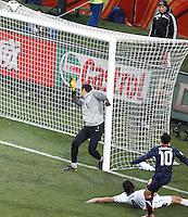 Landon Donovan (R) of USA scores past Slovenia Goalkeeper Samir Handanovic to bring the score back to 2-1