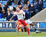 Millwall's Mahlon Romeo tussles with Sheffield United's Billy Sharp during the League One match at The Den.  Photo credit should read: David Klein/Sportimage